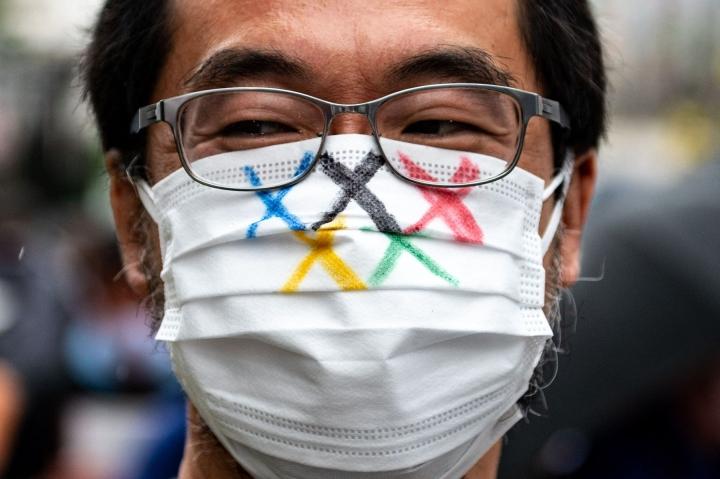 Maanantaina on määrä linjata, pääsevätkö japanilaiset katsojat olympialaisten lehtereille.  LEHTIKUVA/AFP