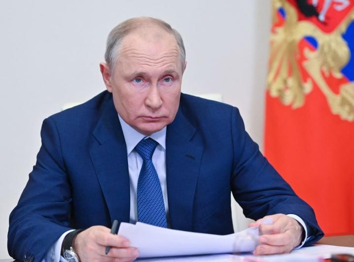 Putinin tiedottajan mukaan Putin tukee vuoropuhelun luomista EU:n ja Venäjän välille. LEHTIKUVA / AFP
