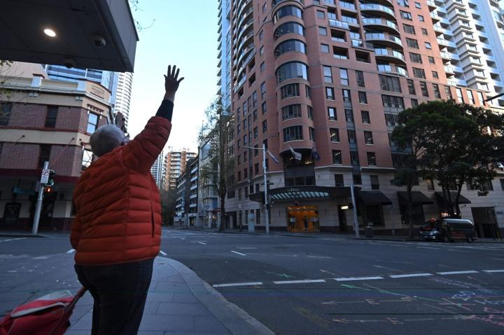 Sydneyn kaduilla Australiassa on ollut hiljaista viime aikoina, kun rajoitustoimia on tiukennettu entisestään. LEHTIKUVA / AFP