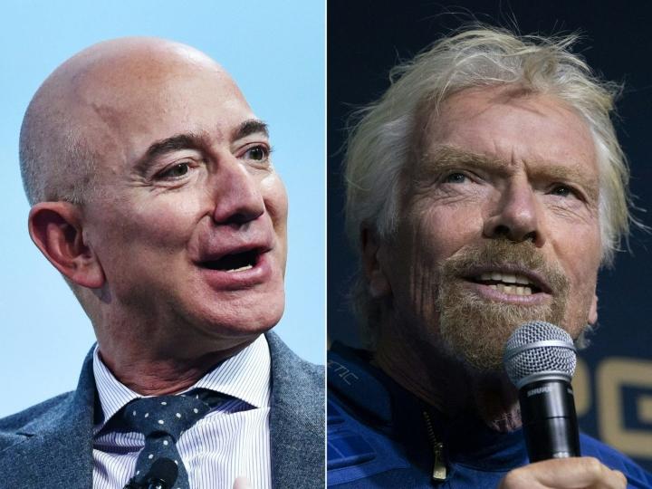 Brittiläinen Virgin-imperiumin luoja Richard Branson (oik.) ja Amazonin amerikkalainen perustaja Jeff Bezos (vas.) pyörittävät kilpailevia avaruusturismiyhtiöitä.  LEHTIKUVA/AFP