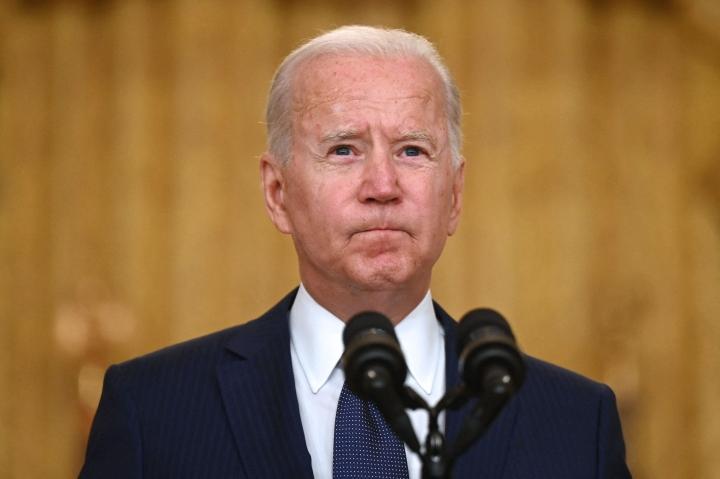 Biden myös uhkauksen iskun tekijöille ja vakuutti, että Yhdysvallat ryhtyy vielä vastaiskuun. Lehtikuva/AFP