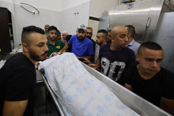 Maanantaisessa laukaustenvaihdossa israelilaisten joukkojen kanssa kuoli ainakin neljä palestiinalaista. LEHTIKUVA/AFP