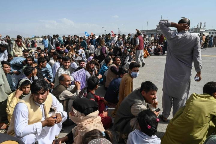 YK:n pakolaisjärjestön mukaan Afganistanin pahentunut tilanne on ajanut tänä vuonna jo yli puoli miljoonaa ihmistä kodeistaan. LEHTIKUVA / AFP