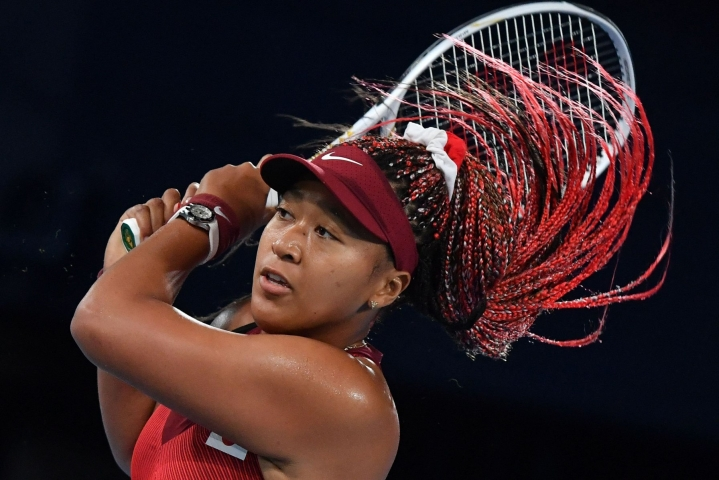 Naomi Osaka karsiutui Tokion olympialaisissa naisten kaksinpelin kolmannella kierroksella. LEHTIKUVA/AFP