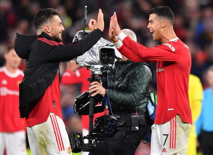 Cristiano Ronaldo (oik.) nousi Mestarien liigan kaikkien aikojen ottelutilaston kärkinimeksi. LEHTIKUVA / AFP