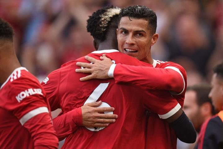 Cristiano Ronaldo viimeisteli kaksi maalia Unitedin musertaessa kotonaan Newcastlen 4–1.  LEHTIKUVA/AFP