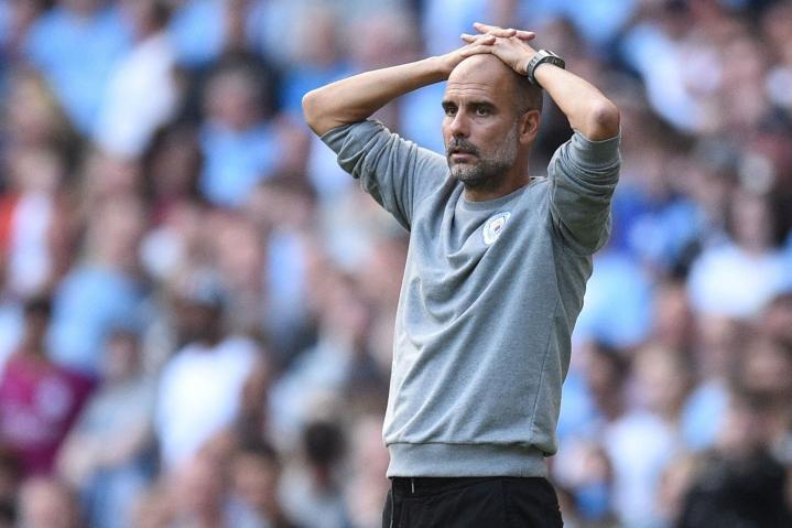 Guardiola on tyytyväinen Cityn nimekkääseen kokoonpanoon, mutta myöntää ostosreissun olevan edessä jossain vaiheessa. LEHTIKUVA/AFP