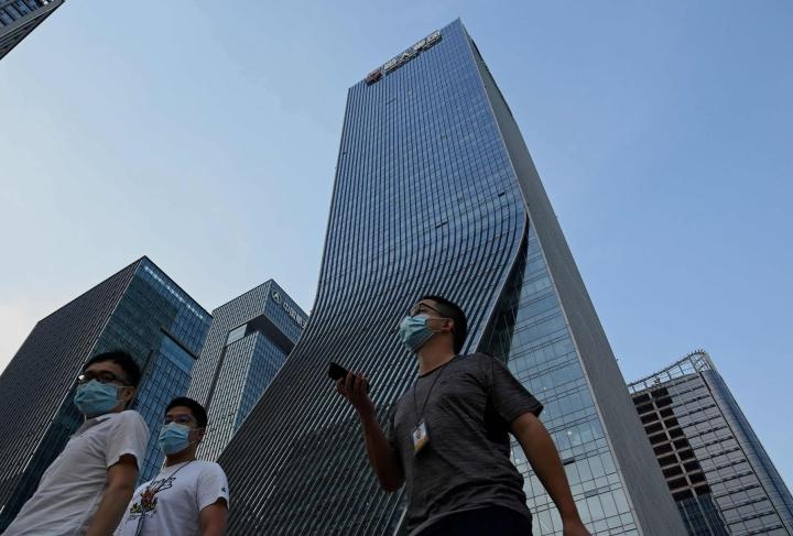 Evergranden talousvaikeuksien pelätään leviävän laajemmalle Kiinan kiinteistömarkkinoilla ja heijastuvan myös muihin maihin. LEHTIKUVA/AFP