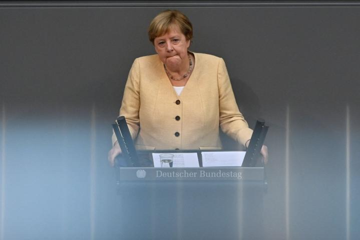 Merkel kommentoi asiaa tiistaina puheessaan Saksan parlamentissa, liittopäivillä. LEHTIKUVA/AFP