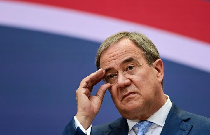 Laschet ja SPD:n Scholz ovat molemmat ilmoittaneet haluavansa muodostaa koalitiohallituksen. LEHTIKUVA/AFP