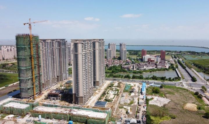 Kiinassa hiekan ja soran kysyntä lisääntyy. Betonia ja asfalttia tarvitaan, kun kaupungit laajentuvat ja uusia moottoriteitä sekä luotijunaratoja rakennetaan. Lehtikuva/AFP