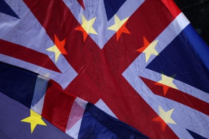 Britannia on myöntänyt, että lain säätäminen rikkoo kansainvälistä oikeutta. LEHTIKUVA / AFP