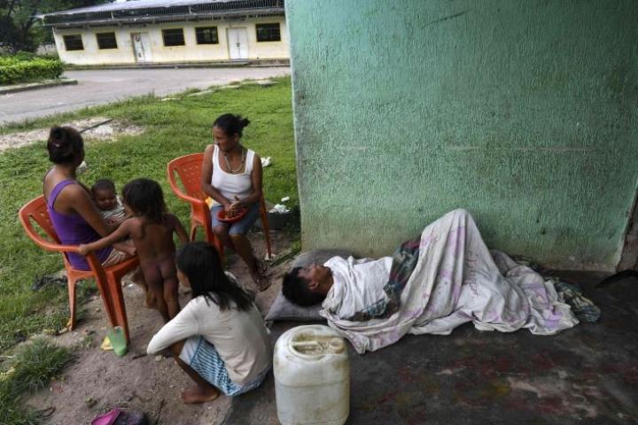 Malariatapausten räjähdysmäinen kasvu on kulkenut käsi kädessä pahentuneen talouskriisin kanssa. LEHTIKUVA/AFP