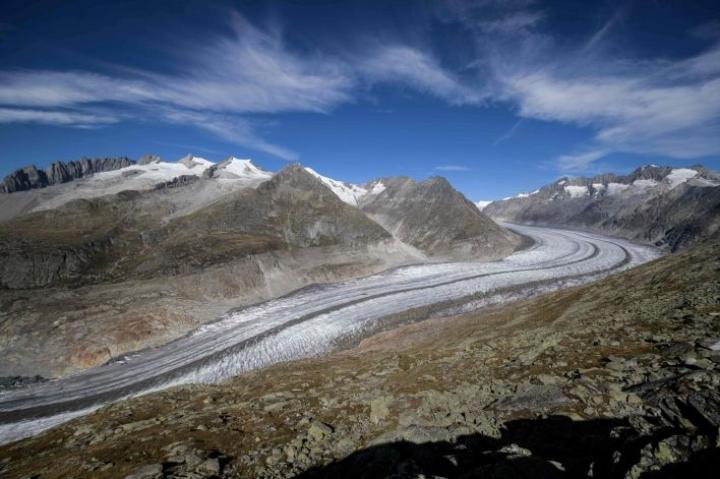 Alppien jäätiköiden sulaminen on nostanut vihreiden suosiota Sveitsissä. Lehtikuva/AFP